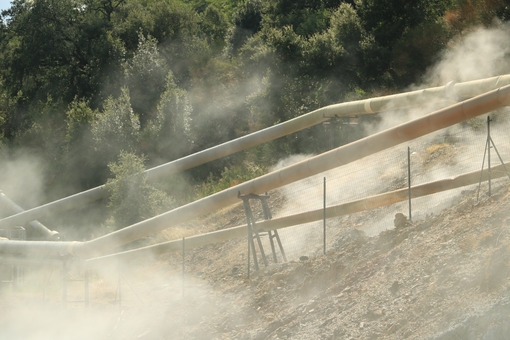 Geothermal field with fumaroles and steam pipes. Geothermal power station.Condensation towers in reinforced concrete. Larderello, Tuscany - LEphotoart.com