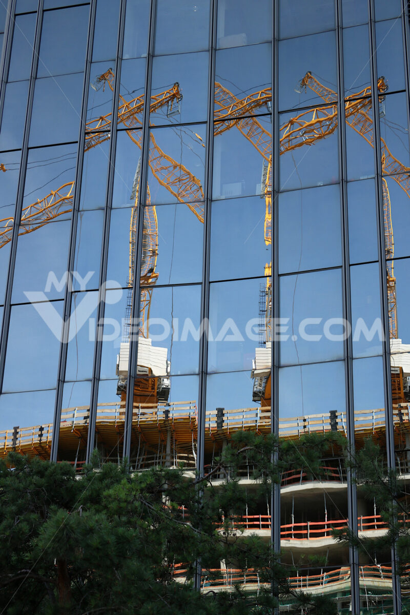 Glass facade of a building with reflection. Building sites. Cantieri edili. - LEphotoart.com
