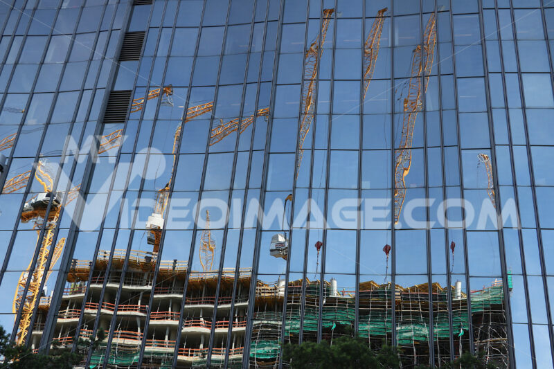 Glass facade of a building with reflection. Building sites. Photo stock royalty free - LEphotoart.com