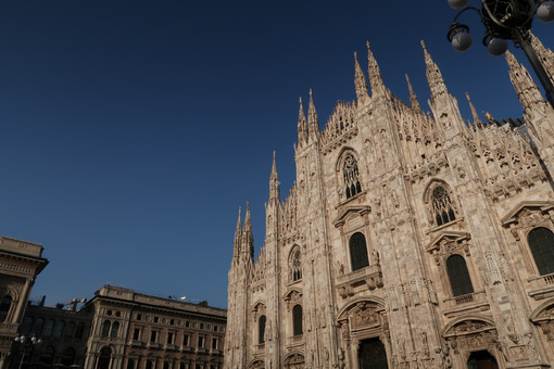 Gothic facade of Milan cathedral in white marble with spiers. - LEphotoart.com