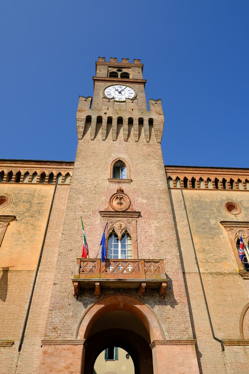 Gothic tower in Busseto. Neo-Gothic tower with clock built in red bricks. Stock photos. - MyVideoimage.com | Foto stock & Video footage