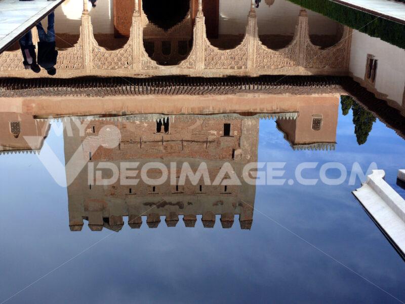 Granada, Spain. Facade reflections on a water basin in the Alhambra. Granada foto. Granada photo