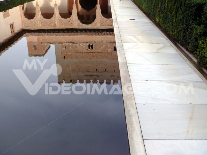 Granada, Spain. Facade reflections on a water basin in the Alhambra. Granada foto. Granada photo