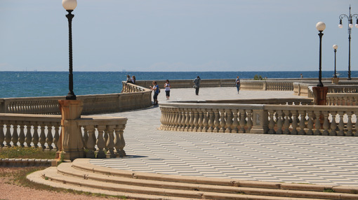 Group of people walking on the seafront of Livorno. The  Mascagni terrace is a famous place and meeting place for the citizens of the Tuscan city. - MyVideoimage.com