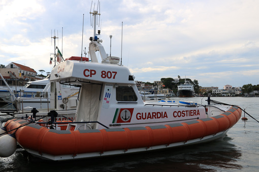 Guardia costiera. Coast Guard boat anchored in the port of Ischia, near Naples. - MyVideoimage.com | Foto stock & Video footage