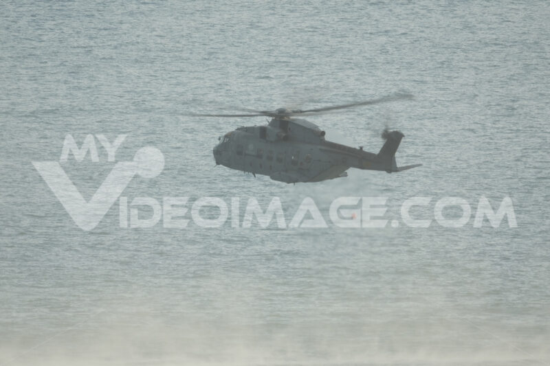 Helicopter. Helicopter on a rescue mission at sea during exercise. Stock photos. - MyVideoimage.com | Foto stock & Video footage