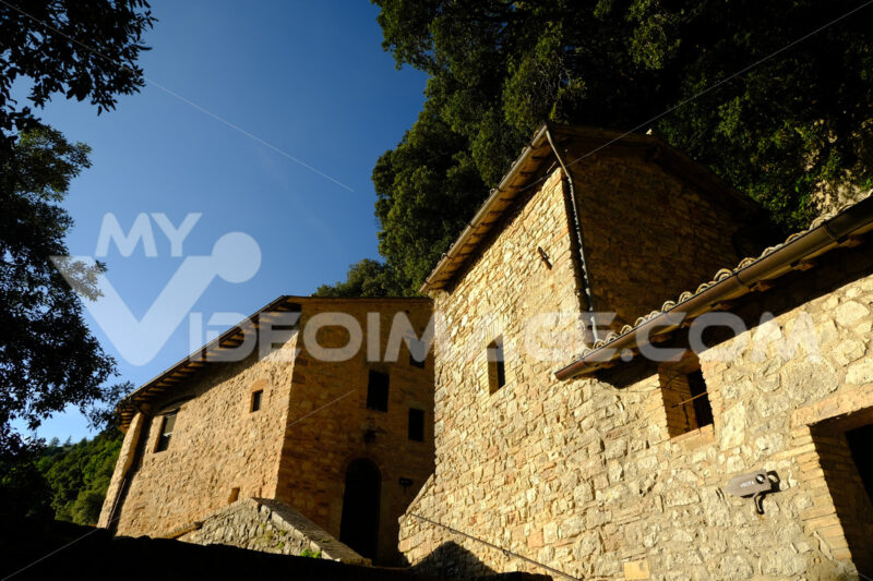 Hermitage of the Carceri of Assisi where St. Francis retired to pray. Made of light stone it is placed inside a forest. - MyVideoimage.com