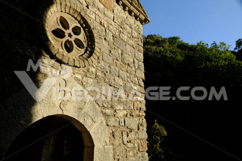 Hermitage of the Carceri of Assisi where St. Francis retired to pray. Small church with a rose window  within the architectural complex. - MyVideoimage.com
