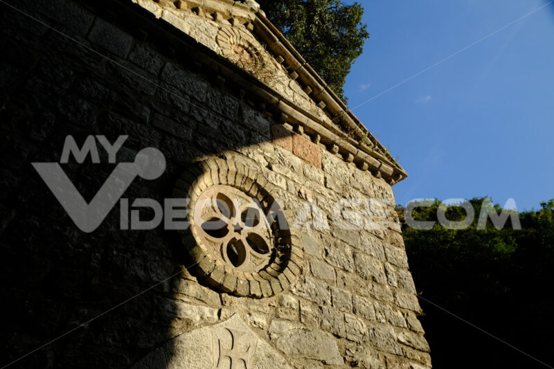Hermitage of the Carceri of Assisi where St. Francis retired to pray. Small church with a rose window  within the architectural complex. - LEphotoart.com