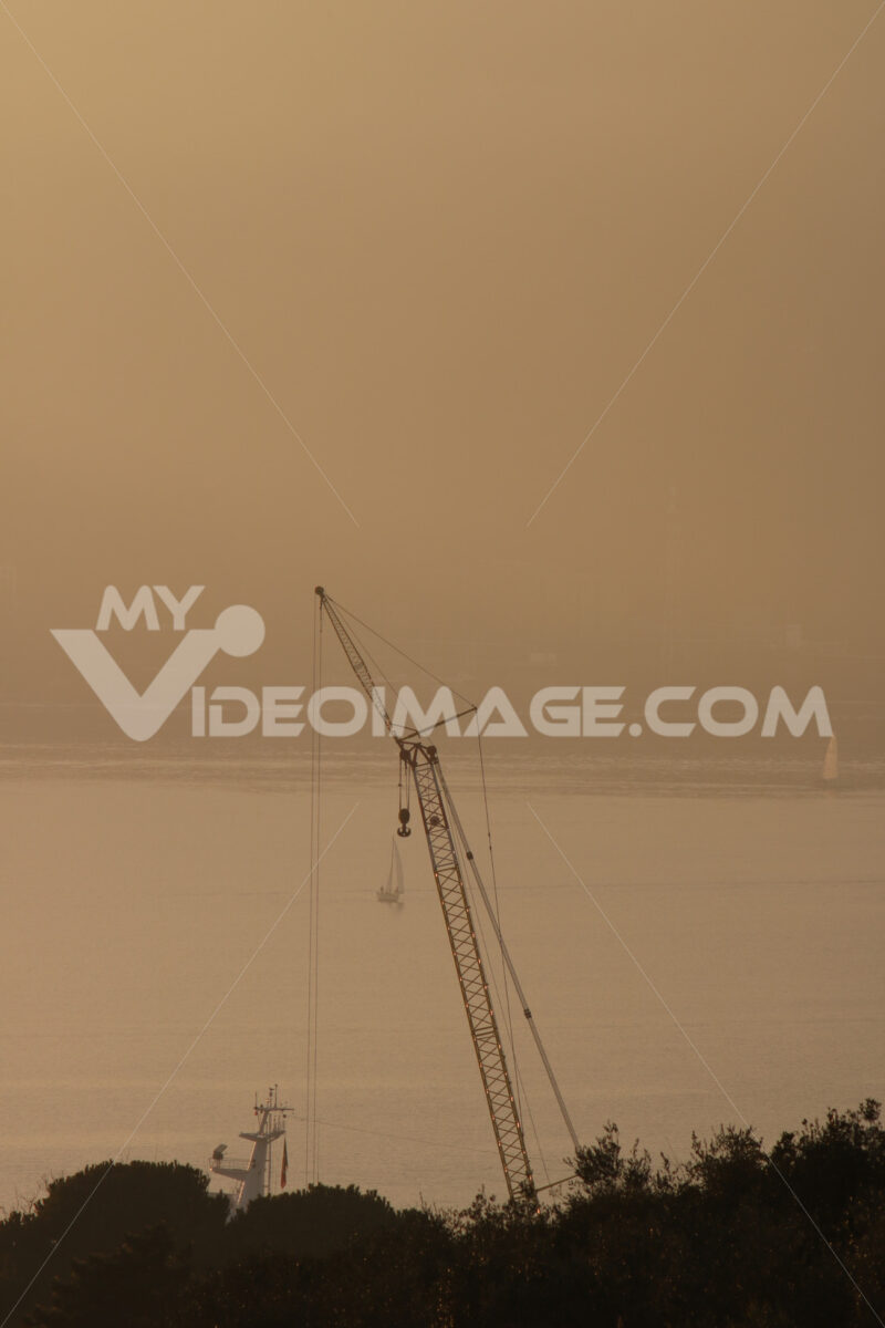 High crane of a shipyard in La Spezia. Warm sunset light. - MyVideoimage.com