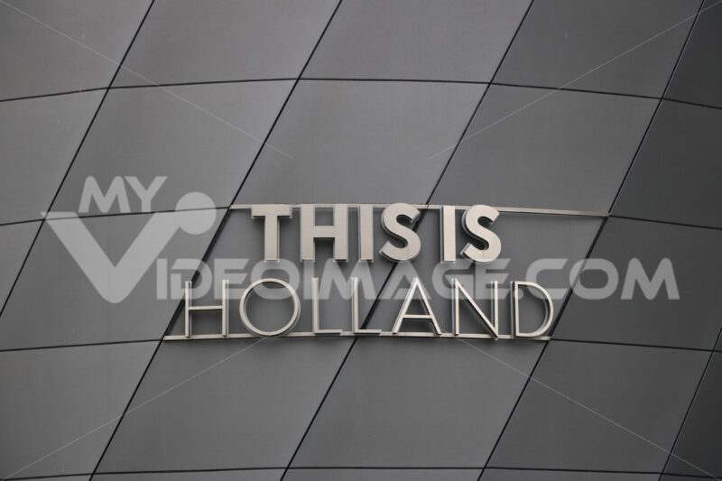 Holland signboard. This Is Holland stainless steel signboard. Gray aluminum facade. - MyVideoimage.com | Foto stock & Video footage