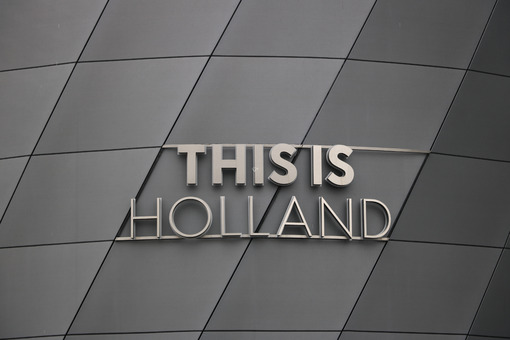Holland signboard. This Is Holland stainless steel signboard. Gray aluminum facade. - MyVideoimage.com   Foto stock & Video footage