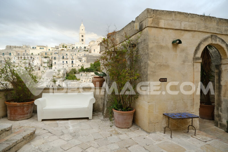 Hotel terrace and courtyard with sofas, chairs and tables overlooking the city of - MyVideoimage.com