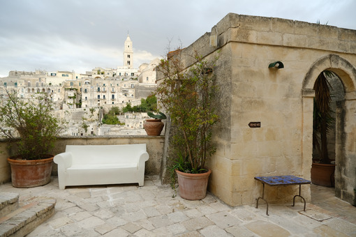 Hotel terrace and courtyard with sofas, chairs and tables overlooking the city of - LEphotoart.com
