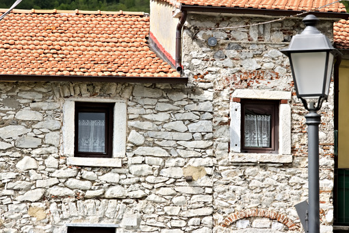 House with walls in white Carrara marble in the town of Colonnata. The village, famous for its lard, is located in a valley of the Apuan Alps. Tuscany - LEphotoart.com