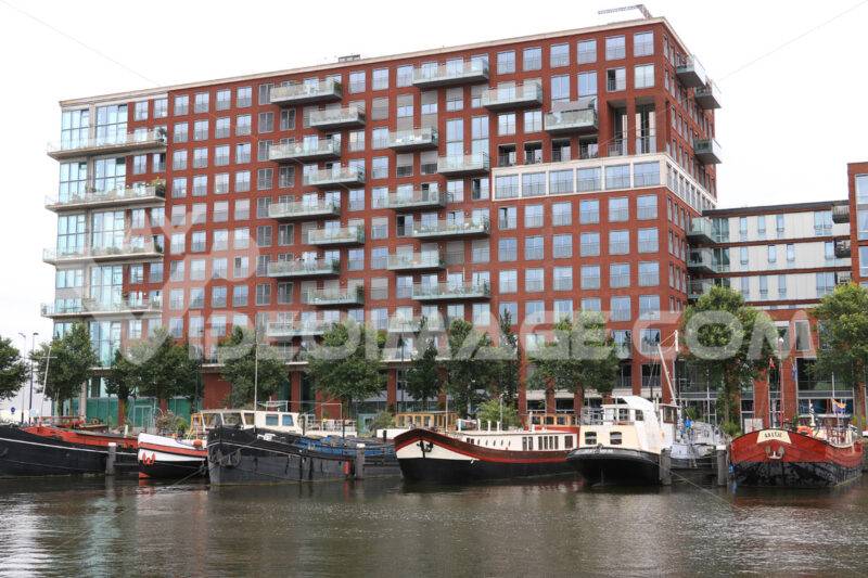 Houseboats and contemporary architecture in Amsterdam. Boats con - MyVideoimage.com
