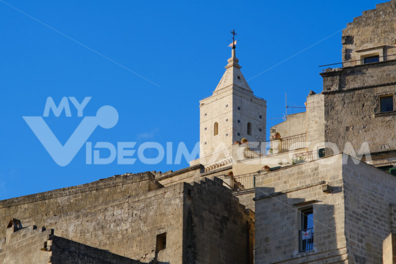 Houses and bell tower in the city of Matera in Italy. The tuff blocks are the material used for the construction of the houses. - MyVideoimage.com