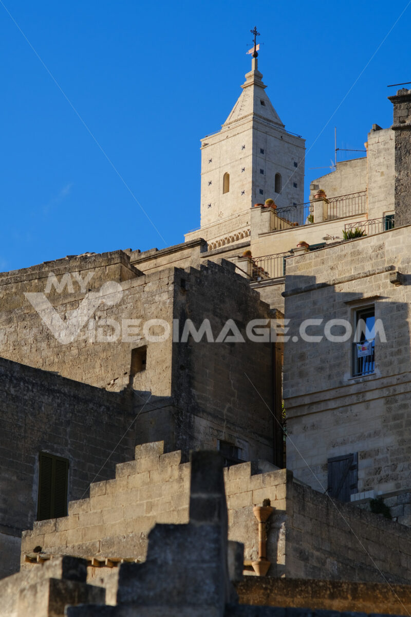 Houses and bell tower in the city of Matera in Italy. The tuff blocks are the material used for the construction of the houses. - LEphotoart.com