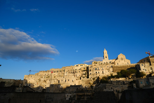 Houses, church and bell tower in the city of Matera in Italy. The tuff blocks are the material used for the construction of the houses. - MyVideoimage.com