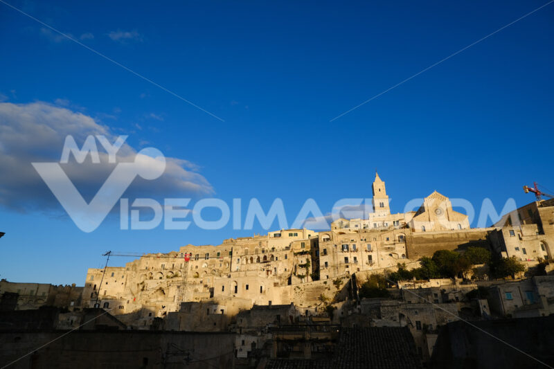 Houses, church and bell tower in the city of Matera in Italy. The tuff blocks are the material used for the construction of the houses. - LEphotoart.com