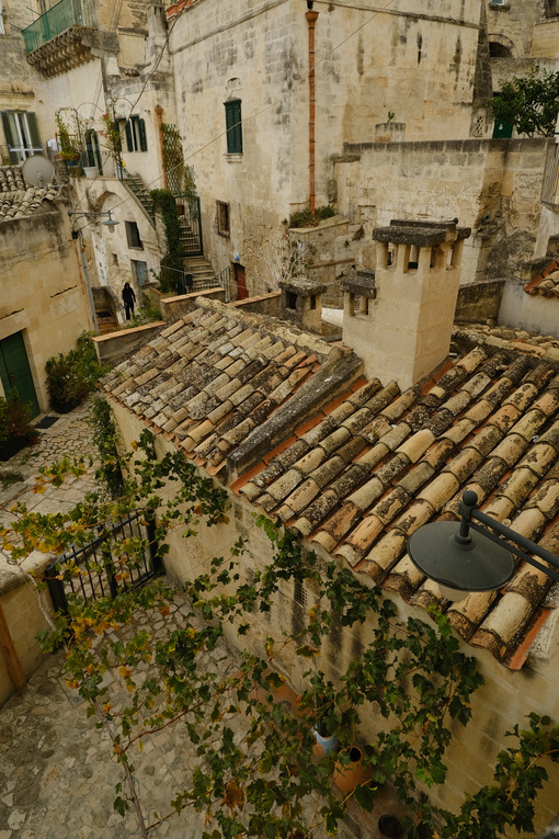 Houses, roads and alleys in the Sassi of Matera. Arbor with vine plants in autumn. - MyVideoimage.com