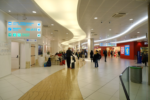 Interior of Bari airport. People leaving waiting for boarding on the plane. - MyVideoimage.com