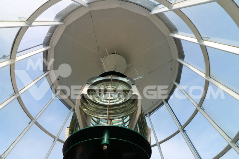 Interior of a lighthouse with optical device with fresnell lenses and lamp. - MyVideoimage.com