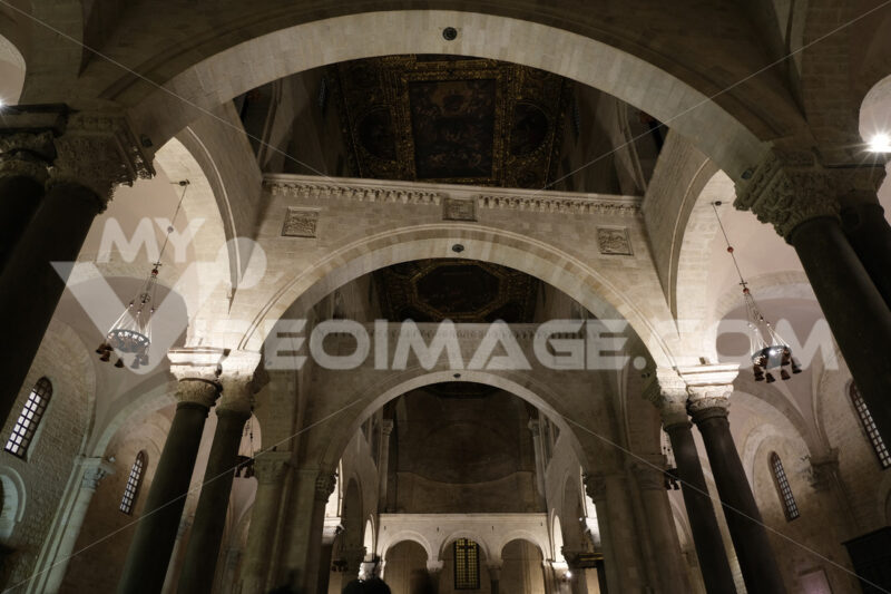 Interior of the Basilica of San Nicola in Bari. Arches, columns, capitals and limestone walls. Foto Bari photo.