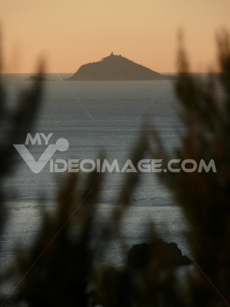 Island of Tino to Al Spezia, with the lighthouse. Pink sunset light. - MyVideoimage.com