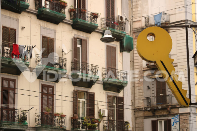 It teaches a large Yale-type key in the background of an apartment building facade. - MyVideoimage.com