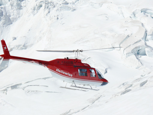 Jungfrau, Switzerlan, 08/06/2009. Red helicopter on high mountai - MyVideoimage.com