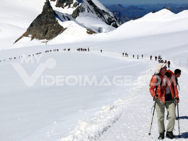 Jungfrau, Switzerland. 08/06/2009. People on snow trails - MyVideoimage.com