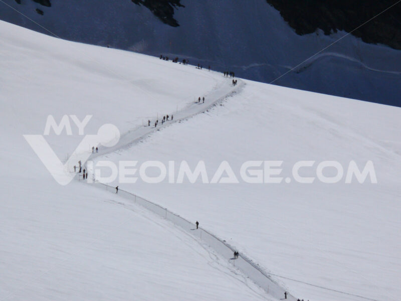 Jungfrau, Switzerland. People on snow trails. Foto Svizzera. Switzerland photo