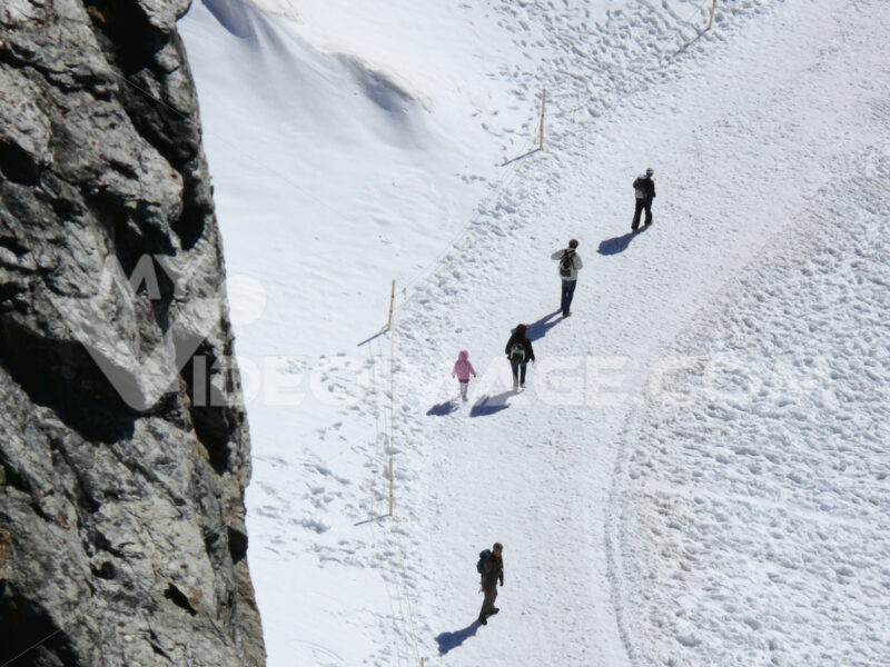 Jungfrau, Switzerland. People on snow trails - MyVideoimage.com