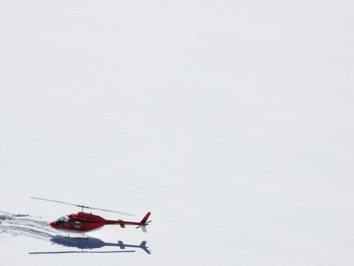 Jungfrau, Switzerland. Red helicopter on high mountain snow - MyVideoimage.com