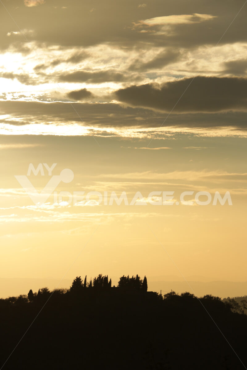 Landscape of the Tuscan hills. Sky with clouds at sunset. Cypres - MyVideoimage.com