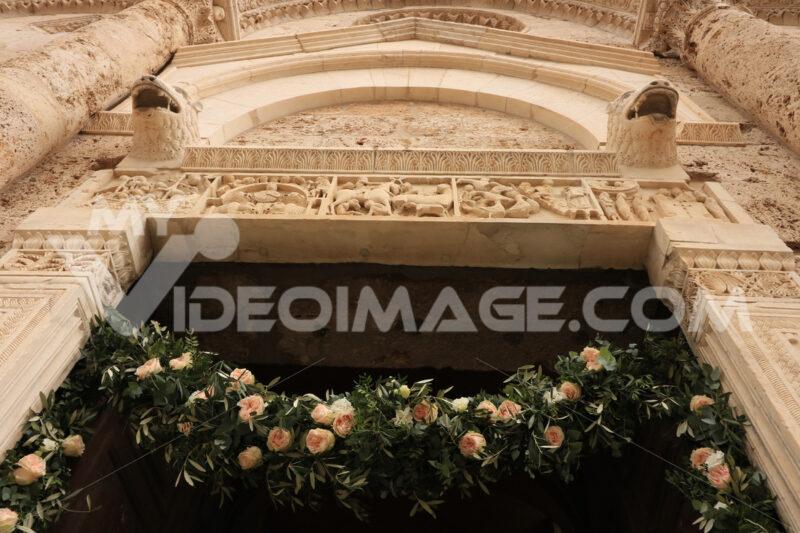 Marble portal of the Massa Marittima church with sculptures. Dec - MyVideoimage.com