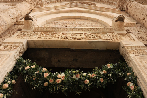 Marble portal of the Massa Marittima church with sculptures. Dec - MyVideoimage.com