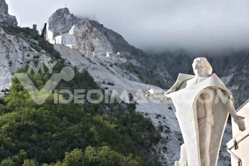 Marble quarries in Colonnata and monument to the quarryman.  The town is famous for the lardo di Colonnata and for the extraction of the white Carrara marble. Colonnata, Carrara, Tuscany, Italy. - LEphotoart.com