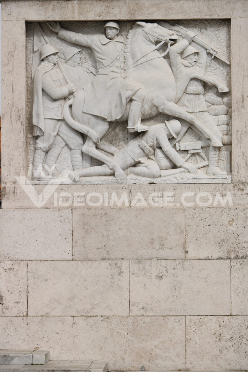 Marble relief with war scene of the fascist period. Rome, Italy. - MyVideoimage.com