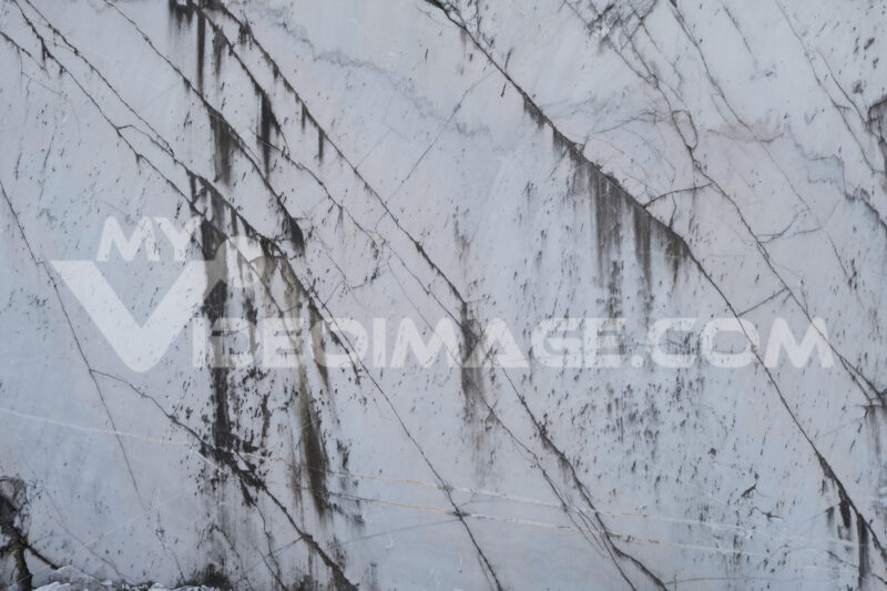 Marble texture. Carrara white marble wall. Rough natural marble surface in a quarry. Stock photos. - MyVideoimage.com | Foto stock & Video footage