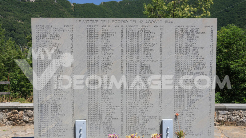 Massacre of Stazzema. Ossuary monument of Sant'Anna di Stazzema. Nazi massacre of 12 August 1944.  Plaque with the list of victims of the massacre. - MyVideoimage.com | Foto stock & Video footage