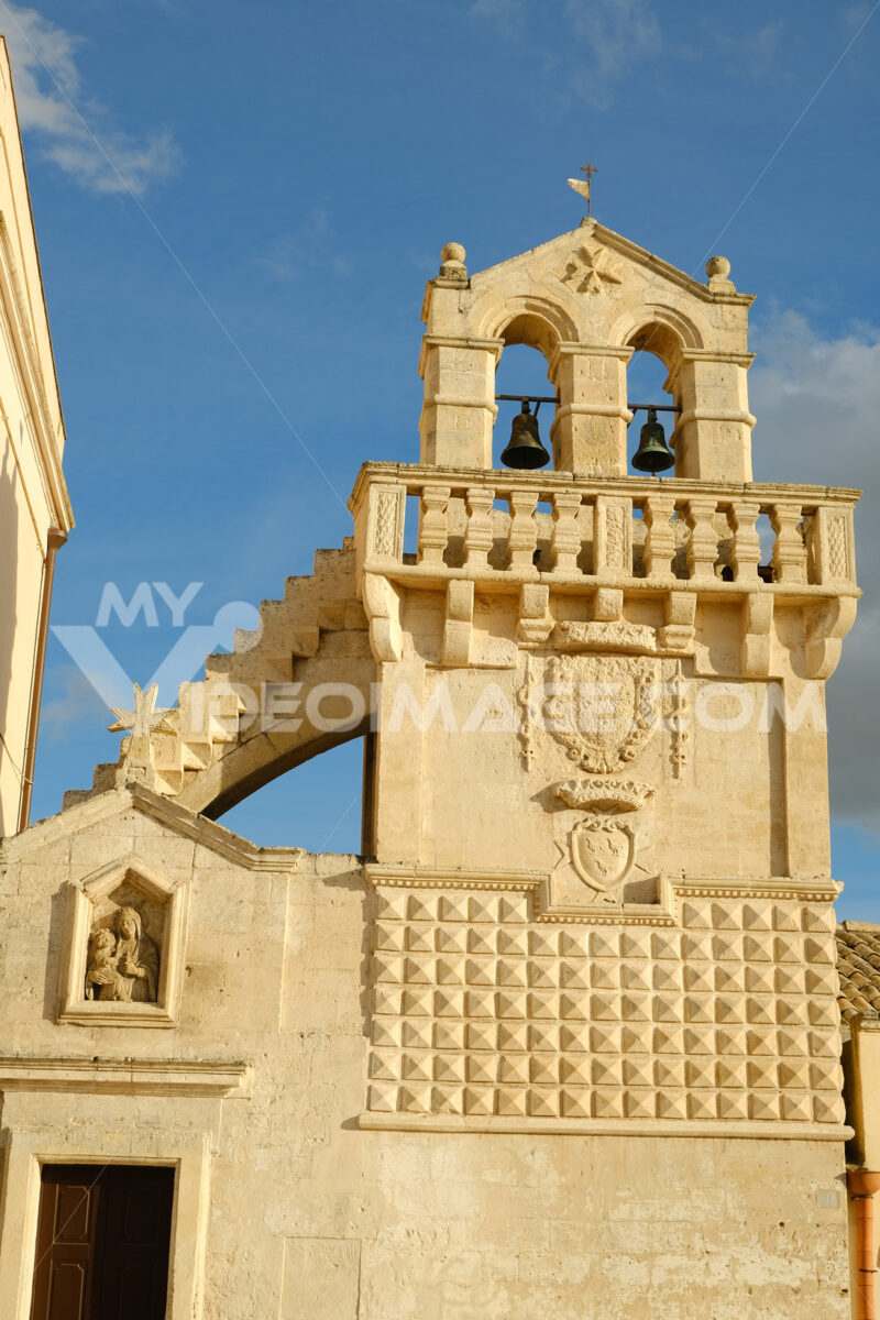 Materdomini Church in Piazza Vittorio Veneto of Matera. Built flat bell tower with balustrade in beige tuff. - LEphotoart.com
