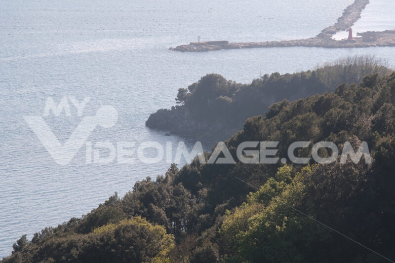 Mediterranean landscape with sea, trees and hills of Liguria. Nature near the Cinque Terre. Lerici, gulf of La Spezia. - MyVideoimage.com