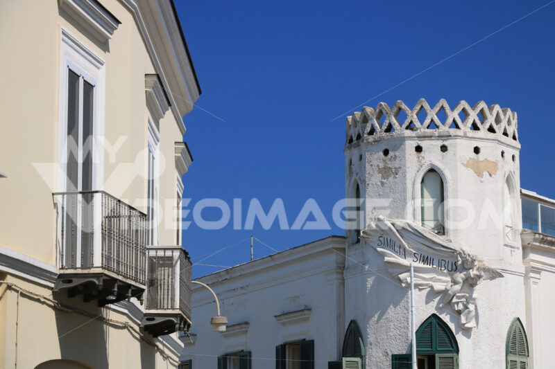 Mediterranean style house with turret on blue sky. On the island - MyVideoimage.com