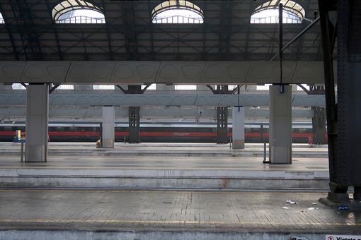 Milan, Central Station. The almost empty station is a red arrow train - MyVideoimage.com
