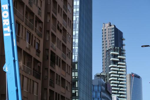 Milan skyscrapers in the Porta Nuova area, Porta Garibaldi. Crane arm for lifting. - LEphotoart.com