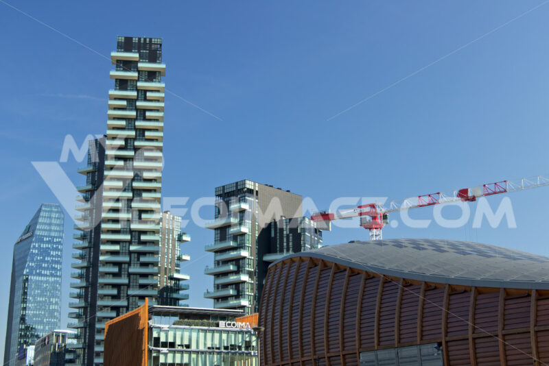 Milan. March 21 2019. Tower crane moving on a construction site in the Business District near the Torre Solaria. - MyVideoimage.com