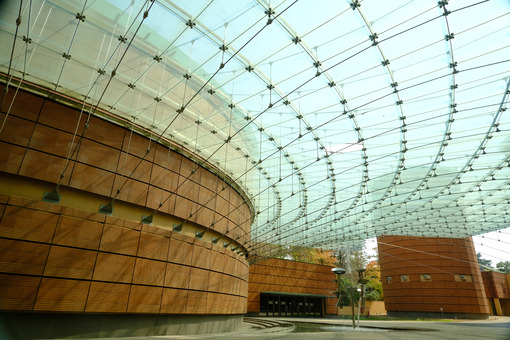 Modern architecture. Modern building with glass roof and brick facade. Stock photos. - MyVideoimage.com | Foto stock & Video footage