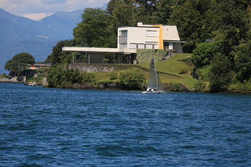 Modern house on the lake shore. A building with a design from th - MyVideoimage.com